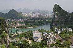 Guilin, view of Li River and Elephant Trunk Hill, one of the hundreds and hundreds of karst formations right in the center of the city, named for its fragrant osmanthus trees.