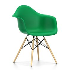 This original and classic EamesDAW Chair from Vitra has a plastic shell with the familiar Eames silhouette, this time with a wooden 'Eiffel Tower' leg base in various finishes.