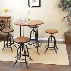 The Hadley 36-inch round bar table offers a multitude of choices to create the perfect counter height dining group for your home. It beautifully combines a rustic chestnut wood finish with textured black metal.