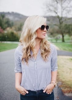 Casual spring outfit with distressed denim & a striped top.