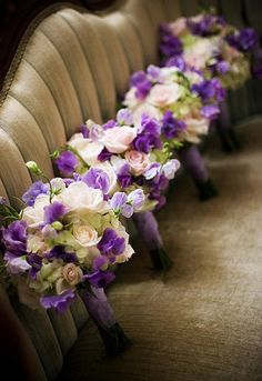bridal party ideas..nice way to shoot all the bouquets..luckily this is a nice sofa.