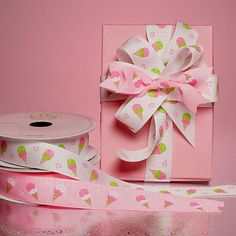 Ice cream cone patterned ribbon perfect for a party on a hot summer day. Decorate using these pink and white decorative grosgrain ribbons for a smashing hit!
