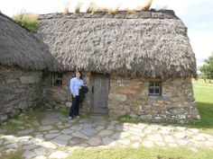 Here's Leannach Farmhouse (where Jamie and eighteen other Jacobite officers took refuge after the battle. You wouldn't think nineteen men could fit in there, but they did). Standing outside: Author Diana Gabaldon