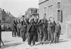 Dutch resistance fighters round up Nazi collaborators, April 19, 1945.