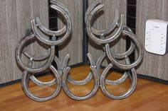 Hey, I found this really awesome Etsy listing at https://www.etsy.com/listing/252696954/horseshoe-wine-rack-wine-rack-metal-wine