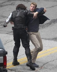 Cap and Winter Soldier fighting on set of CAPTAIN AMERICA: THE WINTER SOLDIER. AAAAHHH!! World, I'm afraid you have over-dosed my geek levels lately...