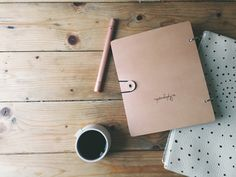 writer's block - digital pen and leather journal on rustic tabletop - meandorla.co.uk