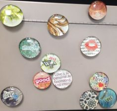 These magnets are a really simple project.  (A set of these might make a good gift!)  All of these were made by cutting colorful images from old magazines. The paper is then mod podged face down on the flat side of the glass marble.  After it dries, a magnet is hot glued on the back.