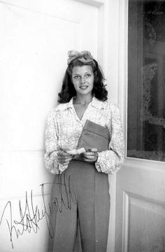 ~Rita Hayworth photo print ad movie start 40s war era fashion style casual pants blouse puff sleeves long white hair