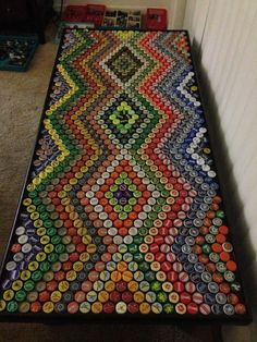 Bottle cap crafts is a fantastic way to make the most out of a bottle top collection that you& not sure what to do with. The type of art . Beer Cap Table, Bottle Cap Table, Beer Bottle Caps, Beer Caps, Beer Bottles, Beer Pong, Bottle Top Art, Bottle Top Crafts, Bottle Cap Projects
