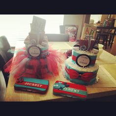 Thing 1 and Thing 2 diaper cakes with personalized wipe cases ! Love the skirt for Remy