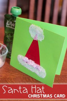 Quick and easy is a must in the holiday season. Try this very quick and easy Santa hat Christmas card to make with the kids. Its cute too!