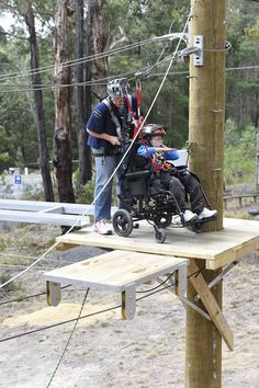 Kristen Versteege-Brown helps Elias Anderson 11yrs Conquer the High Ropes Course. PICTURE: JUSTIN WHITELOCK