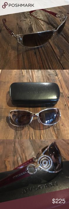 Bvlgari 6003 B women's sunglasses Bvlgari 6003 B women's sunglasses. Used. Very good condition. Made in Italy. Bvlgari case included. Red and silver frame with crystals. Brownish gray lenses. bvlgari Accessories Sunglasses