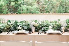 Lush Foliage Table Décor      Photography: Lucas Rossi and Michelle Kyle     Read More:   http://www.insideweddings.com/weddings/inspirational-outdoor-garden-wedding-shoot-with-modern-elements/687/