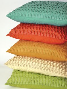 These colors would help liven up our very brown living room. Colonnade pillows in aqua, melon, pecan, oyster and green from Company C.