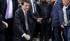 Manuel Valls, French Prime Minister, tries his hand at petanque on a visit to…
