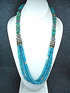 Tommy Singer Sterling Silver 3 Strand Sleeping Beauty Turquoise Necklace. The Single Strand is Kingman Turquoise and the 3 lower strands are Sleeping Beauty with Sterling Silver Signature Beads and Sterling Silver elongated beads and Sterling Silver spacers throughout 28 inches long hook clasp.