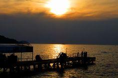 Sunset reflects on the Mediterranean Sea at Sorrento, Italy, on the Amalfi Coast. | FlorenceForFun