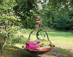 Jasmin Swing features twisted curling florets of wrought iron tumbling down enclosing a nest of cushions and comfort. Sweetly scented climbing jasmin can also be intertwined to complement the swings natural surroundings in your garden by Myburgh Designs. Oh love!