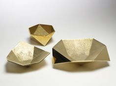Origami Bowls  These cast metal vessels are indebted to origami forms. Available in brass and aluminum. Set of three.  designer Ayush Kasliw...