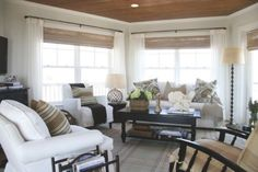 Design Tips: Cottage Style Decorating//wooven wood, black rods, sheer white/cream panels