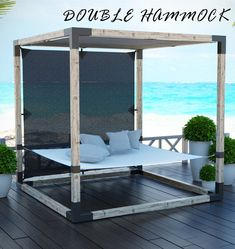 Lounge with loved ones on a cozy and comfy double hammock - the perfect piece to complete your backyard oasis.