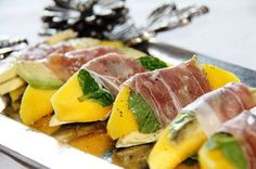 Prosciutto Wrapped Mango Bites. Serve your guests with this quickly served appetizer. Cut mango into slices, lay each slice on srugula and basil. Wrap mango slices in a strip of prosciutto. Add some pepper for ingredients. http://hative.com/creative-diy-party-food-ideas/