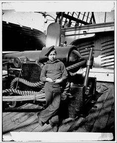 A Powder monkey by gun of U.S.S. New Hampshire off Charleston, S.C. Original Photographs from the Civil War