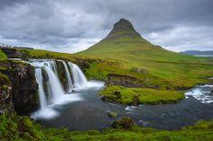 Kirkjufellsfoss (the waterfall) and, on the background, Kirkjufell (the mountain).
