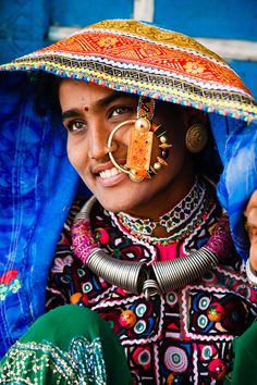 Portrait of a woman from the Marwada Meghwal Harijan tribe wearing traditional clothing and a large golden wedding ring through her nose in the village of Zura, located roughly from Bhuj in the Kutch District. We Are The World, People Around The World, Ethnic Jewelry, Namaste, Tribal India, Tribal People, Indian Textiles, Portraits, Photography Portfolio