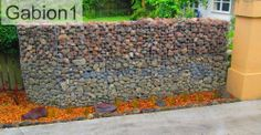 Low Cost Gabion entry fence with 2 tones of rounded river rocks. Cheaper than block stone gabion walls are easy to build  http://www.gabion1.com.au