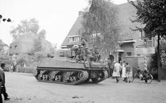A Sherman tank of 11th Armoured Division passing through Leende, 22 September 1944.