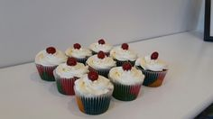 Rainbow cupcakes, white buttercream and a cherry on top. #rainbow #cupcakes