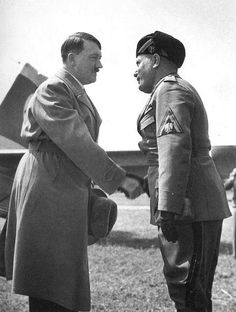 Mussolini and Hitler shaking hands by Alfred Eisenstaedt [double infamous]