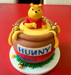 Winnie the Pooh honey pot cake by Cake Couture.   Cake Couture fondant.