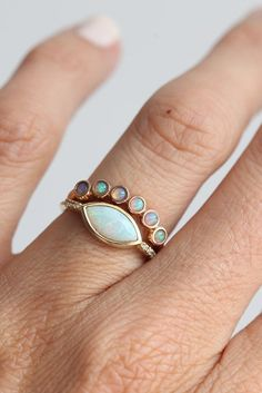 A twinkling band of opal makes a one-of-a-kind wedding band