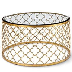 OK...a table kind of like THIS is what I need! Only not perfectly round...maybe oval? And not shiny gold...maybe an antiqued gold or bronze color? And the top can't be glass until the kids are older...maybe plexiglass? Hmmm...maybe not. :D ~SP