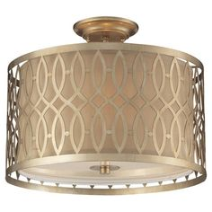 Cast a warm glow in your entryway or den with this lovely semi-flush mount, showcasing a geometric lattice overlay and an aged silver finish.   ...