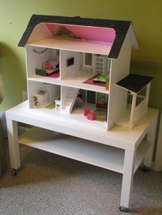 Dollhouse on ikea coffee table with casters.