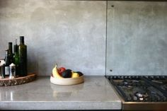 Concrete Bench Top with Glass Splash Back Concrete Bench Top, Concrete Kitchen, Kitchen Splashback Tiles, Stainless Backsplash, Open Plan Kitchen Dining, Kitchen Benches, Dark Blue Kitchens, Looking For Houses, Concrete Interiors
