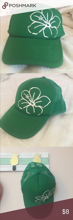 green baseball cap with flower this is a green baseball cap with a kind of mesh back and a white flower on the front. the size is adjustable on the back as well. there is also a $5 shipping Accessories Hats