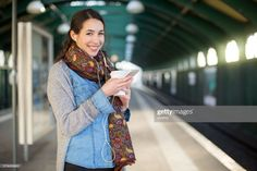 View top-quality stock photos of Smiling Young Woman Waiting At Subway Station. Find premium, high-resolution stock photography at Getty Images. Instagram Story Ideas, Listening To Music, Social Platform, Young Women, Photoshoot, Stock Photos, Train Station, Waiting, Lifestyle