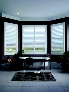 Luxaflex® Vinyl Shutters create a real sense of style in this bathroom combining elegance and durability for steamy rooms. They won't chip, crack, fade or warp, no matter how hot it gets.  Luxaflex® Faux Wood Shutters are expertly hand crafted in the UK and come with a reassuring 10 year guarantee.