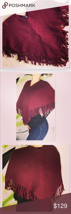 "Burberry London Cashmere Wool burgundy Poncho Cape Burberry London Cashmere Wool burgundy Poncho Cape is a beautiful addition to your closet. 50% wool 50% cashmere, soft and warm poncho with fringe detail. Stylish and classy. One size fits most. Great pre owned condition, no damages, stains or holes, minimal signs of wear. Beautiful burgundy color. Measurements: 27"" x 22"" ( laying flat side to side width x length) Burberry Sweaters Shrugs & Ponchos"