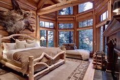 Rustic bedroom, fireplace and huge windows...