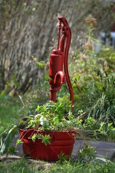 Old Water Well. love this and love that it is painted red. for some reason I like wagon wheels painted red too. Hand Pump Well, Old Water Pumps, Garden Yard Ideas, Garden Fun, Pump It Up, Water Well, Milk Cans, Garden Ornaments, Water Garden
