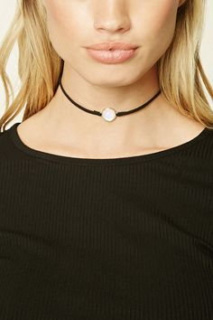 A faux suede choker featuring an iridescent faux stone and a lobster clasp closure.