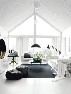 white living space with gable ceiling