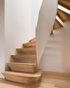 A twisted staircase features at the centre of this family home.